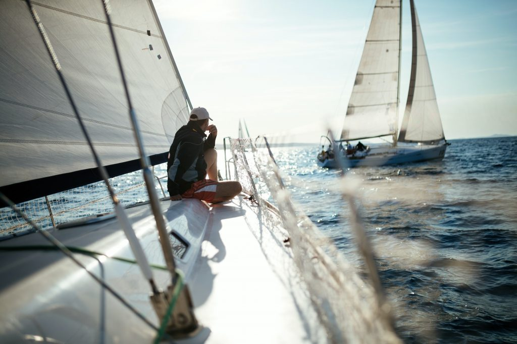 Young handsome man relaxing on his sailboat