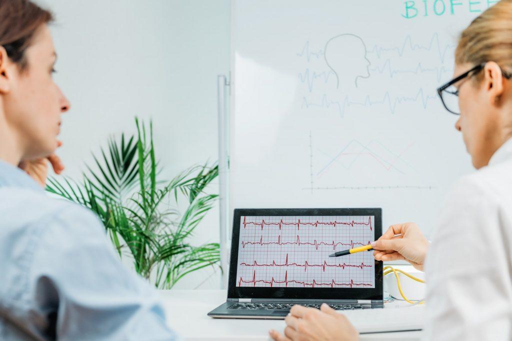 Biofeedback Training. Biofeedback Practitioner and Patient in Consultation